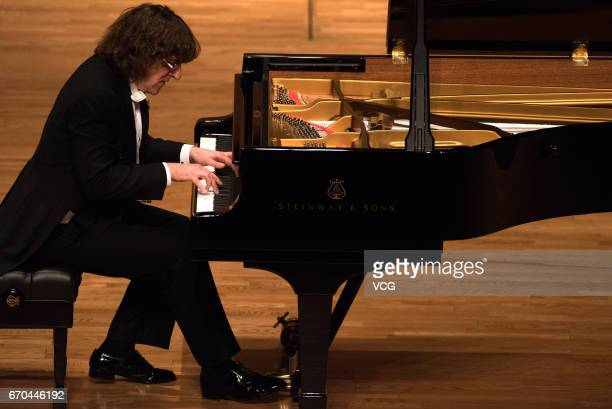 Russian pianist Sergey Tarasov performs during his solo concert at Shengjing Grand Theatre on April 19 2017 in Shenyang Liaoning Province of China