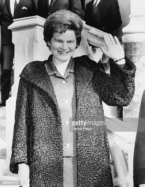 Russian pilot and astronaut Valentina Tereshkova waving outside the Russian Embassy in London February 5th 1964