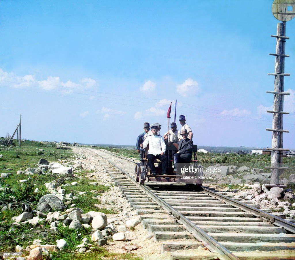 Russian pioneer of colour photography Sergey Prokudin-Gorsky (1863 - 1944, seated, right), an official and four railway workers riding on a railway handcar on the Murmansk Railway outside Petrozavodsk, Karelia, in the Russian Empire, 1915. Under the sponsorship of Tsar Nicholas II, Prokudin-Gorsky toured the Russian Empire by rail between 1905 and 1915, documenting its culture and landscape in colour.