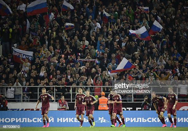 Russian players celebrate a goal during their UEFA Euro 2016 qualifying round Group G football match between Russia and Sweden at Otkrytie Arena in...