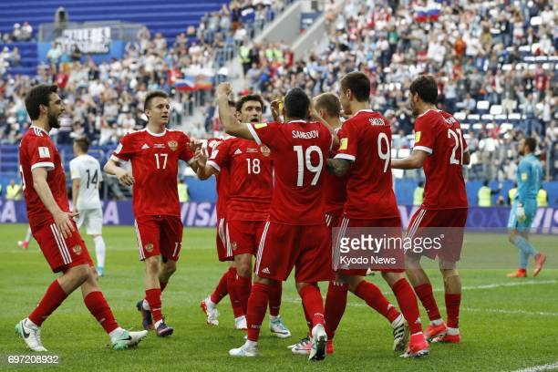 Russian players celebrate after an own goal by New Zealand's Michael Boxall gives them a 10 lead in the Confederations Cup opening match at Saint...