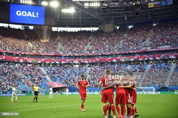 TOPSHOT Russian players celebrate after Russia's forward Fedor Smolov scored the team's second goal during the 2017 Confederations Cup group A...