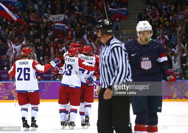 Russian players celebrate after scoring a disallowed goal against the United States during the Men's Ice Hockey Preliminary Round Group A game on day...