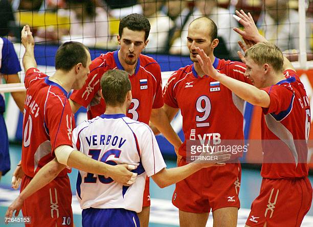 Russian players celebrate after scoring a point during the third set of their Pool E second round match against Puerto Rico at the Men's World...