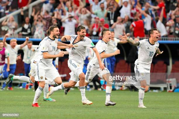 Russian players celebrate their victory through the penalty shootout in the 2018 FIFA World Cup Russia Round of 16 match between Spain and Russia at...