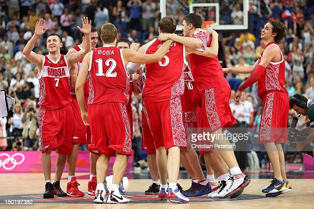 Russian players celebrate winning the Men's Basketball bronze medal game between Russia and Argentina on Day 16 of the London 2012 Olympics Games at...