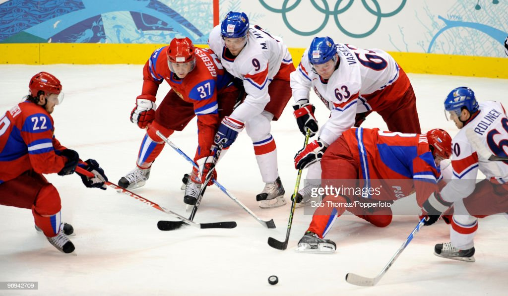 Russian players Konstantin Korneyev #22, Denis Grebeshov #38 and Pavel Datsyuk try to reach the puck with the Czech Republic's Milan Michalek #9, Josef Vasicek #63 and Tomas Rolinek #60 during the ice hockey men's preliminary game between Russia and Czech Republic on day 10 of the Vancouver 2010 Winter Olympics at Canada Hockey Place on February 21, 2010 in Vancouver, Canada.