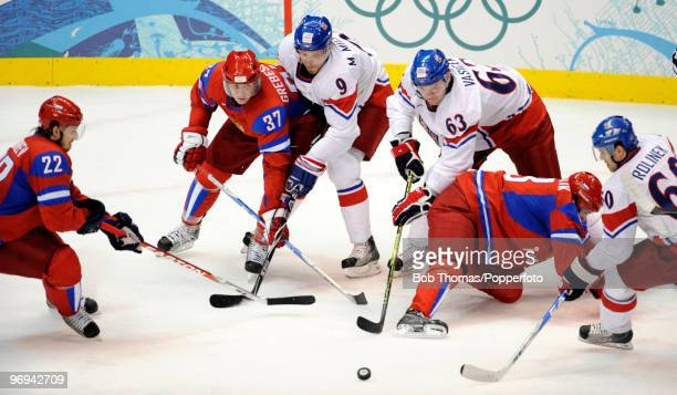 Russian players Konstantin Korneyev Denis Grebeshov and Pavel Datsyuk try to reach the puck with the Czech Republic's Milan Michalek Josef Vasicek...