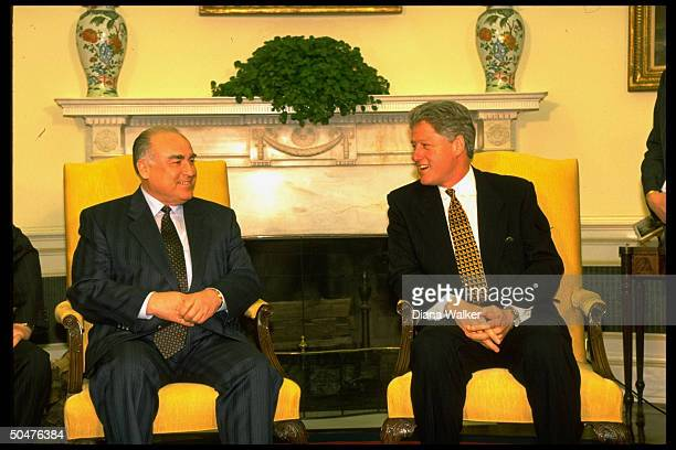 Russian PM Viktor Chernomyrdin mtg w Pres Bill Clinton sitting in front of Swedish ivytopped fireplace in WH Oval Office