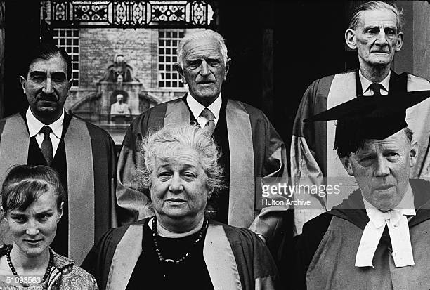 Russian poet and author Anna Akhmatova front row center sits between her niece and Australianborn Vice Chancellor of Oxford University Dr Kenneth...