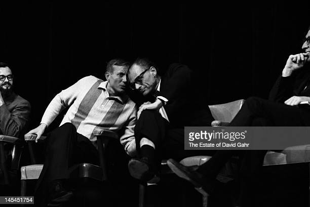 Russian poet Yevgeny Yevtushenko and playwright and essayist Arthur Miller confer on stage in November 1966 at an event for Mr Yevtushenko at Queens...