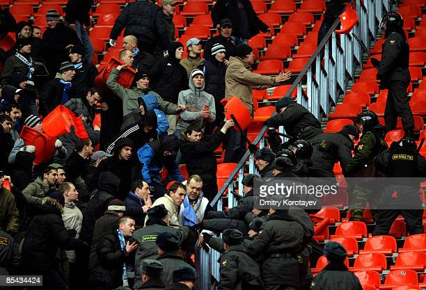Russian police clash with Zenit Saint Petersburg fans during the Russian Football League Championship match between Spartak Moscow and Zenit at the...