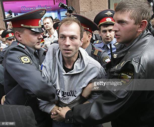 Russian police forces arrest a farright activist during a banned gay rally in Moscow on June 1 2008 Russian gays defied a ban by city authorities and...