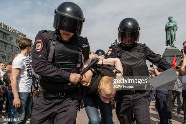 Russian Police forces seen arresting a protester during the demonstration Opposition supporters gathered on Saturday at the Pushkin Square in Moscow...