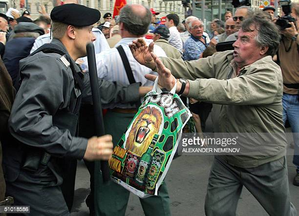 Russian police forces try to disperse Communist supporters 02 July 2004 during outside the State Duma a protest against the government's social...