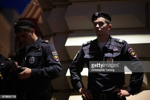 Russian police keep a watchful eye on football fans on Nikolskaya Street near Red Square on June 19 2018 in Moscow Russia