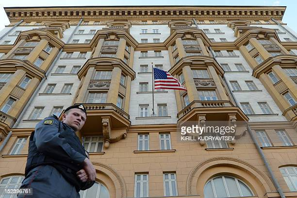 A Russian police officer patrols a street in front of the US Embassy in Moscow the headquarters of US Agency for International Development Russia's...