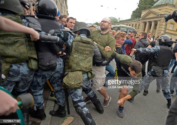 Russian police officers and protestors opposed during a rally against governemnt plans to hike the retirement age in Saint Petersbourg on September 9...