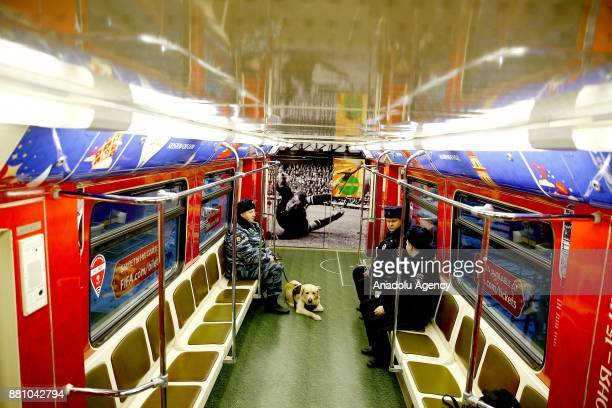 Russian Police officers are seen with a dog inside the train with 2018 FIFA World Cup Russia branding during the unveiling of the 2018 FIFA World Cup...
