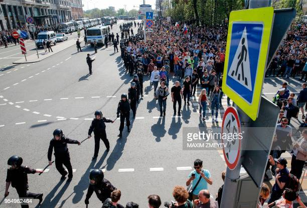 Russian police officers block protesters during an unauthorized antiPutin rally called by opposition leader Alexei Navalny on May 5 2018 in Moscow...