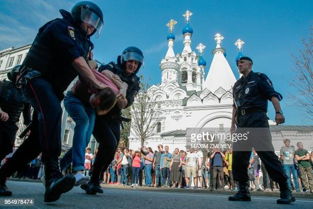 TOPSHOT Russian police officers detain a protester during an unauthorized antiPutin rally called by opposition leader Alexei Navalny on May 5 2018 in...