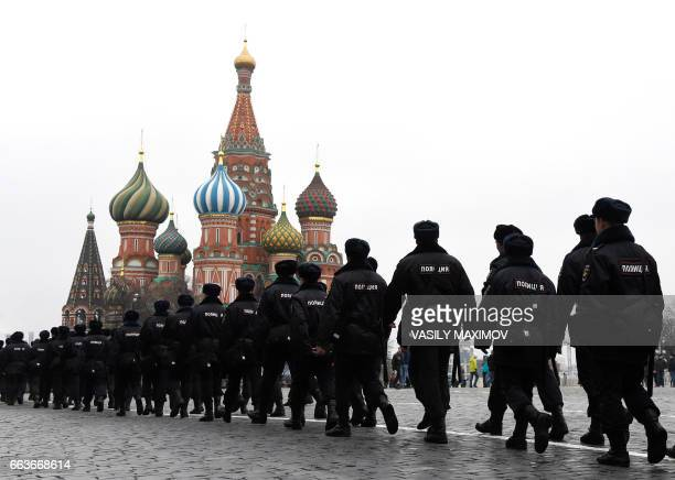 TOPSHOT Russian police officers patrol on the Red Square in central Moscow on April 2 as Russian opposition promised protests after police detained...
