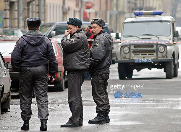 Russian police officers stand at the site where a student from Senegal was killed 07 April 2006 in SaintPetersburg A student from Senegal was shot...
