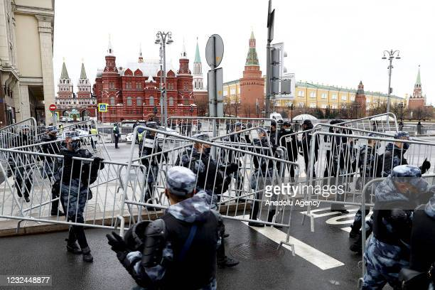Russian police officers stand guard around the Kremlin Palace and Red Square as supporters of opposition activist Navalny take part in an...