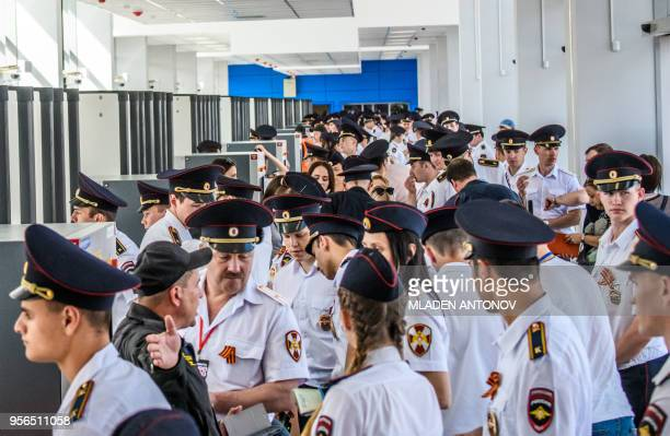 Russian police officers stand guard next to metal detectors at the entrance of Volgograd Arena in Volgograd on May 9 2018 The nearly 45000seater...