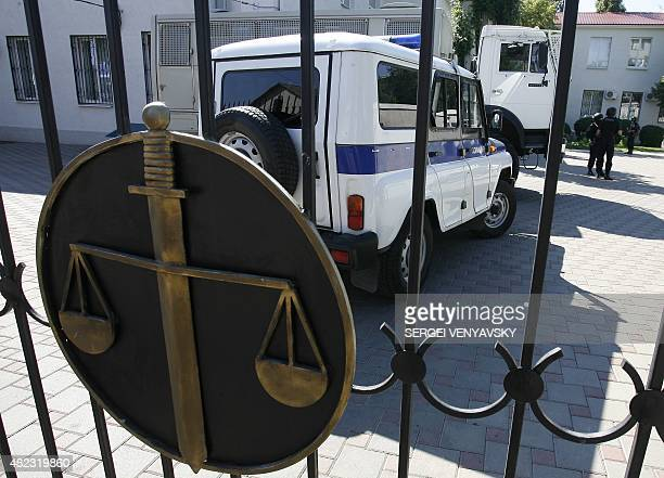 Russian police vehicles block the court yard in Donetsk, in the Rostov-on-Don region of Russia, on July 30 where the high-profile trial of the...