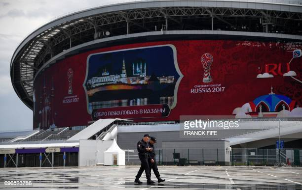 Russian policemen patrol outside the Kazan Arena stadium in Kazan Russia on June 16 2017 ahead of the Russia 2017 Confederations Cup football...