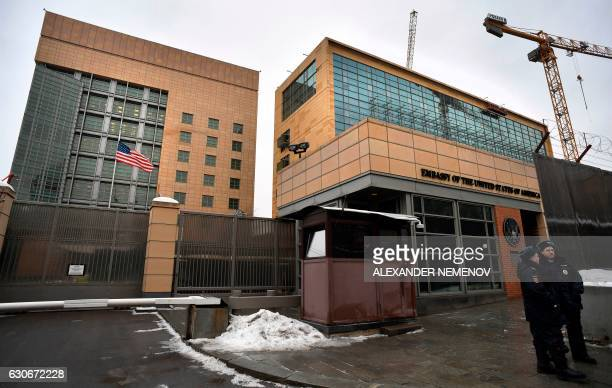 Russian policemen stand guard in front of the US Embassy in Moscow on December 30 2016 Russia on December 30 2016 eyed retaliatory measures against...