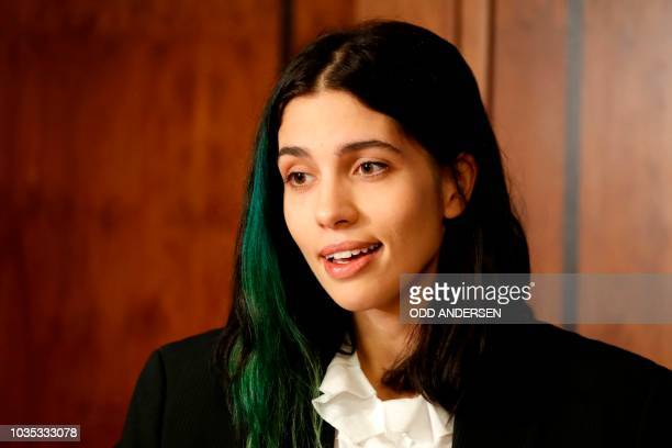 Russian political activist member of the Russian punk band Pussy Riot and Pyotr Verzilov's wife Nadezhda Tolokonnikova speaks during a press...