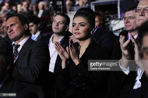 Russian politician and former Olympic Champion Alina Kabaeva aplauds as Prime Minister Vladimir Putin delivers his speech at the congress of the...