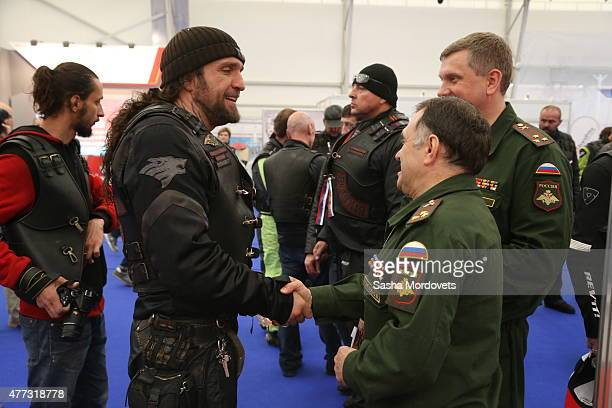 Russian politician and Nignt Wolves Bikers Club President Alexander Zaldostanov also known as 'Khirurg' shakes hands with an officer during his visit...