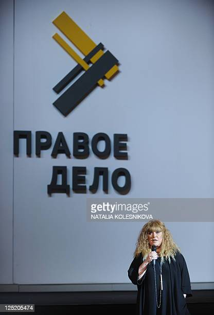 Russian pop singer Alla Pugacheva speaks at a congress of proreform Pravoye Delo party in Moscow on September 15 with the party's logo in the...