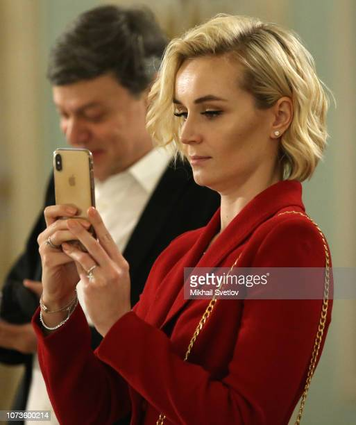 Russian pop singer Polina Gagarina takes a photo with her iPhone during the meeting with members of Presidential Council on Culture at Konstantin...