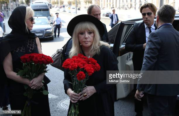 MOSCOW RUSSIA SEPTEMBER2 Russian pop star Alla Pugacheva her husband Maksim Galkin and her daughter Kristina Orbakaite arrive for the funeral of...