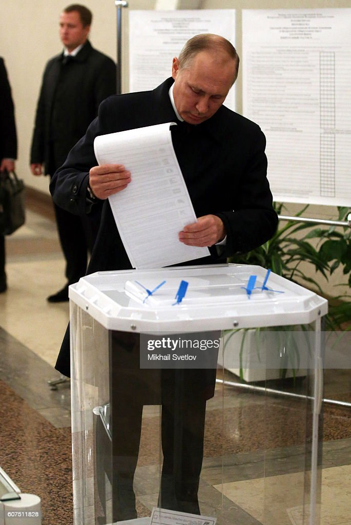 Russian Preisdent Vladimir Putin holds a ballot paper as he votes at a polling station on September 18, 2016 in Moscow, Russia. Legislative parliamentary elections take place across Russia today.