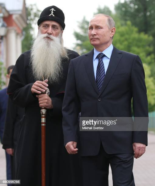 Russian Preisdent Vladmir Putin and Metropolitan Korniliy are seen while visiting Russian Orthodox OldRite Church at Rogozhskoye Cemetery in Moscow...