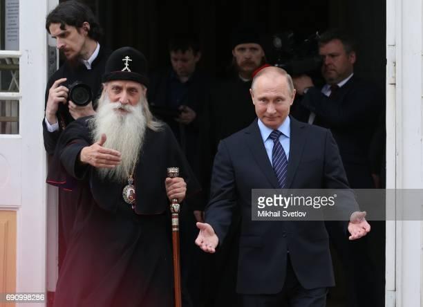 Russian Preisdent Vladmir Putin and Metropolitan Korniliy are seen while visiting Russian Orthodox OldRite Church at Rogozhskoye Cemetery in Moscow...