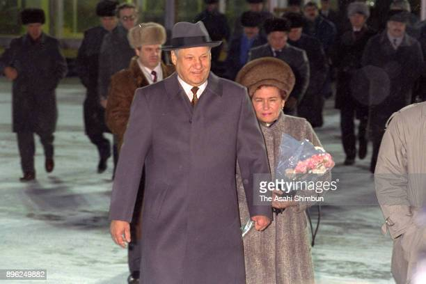 Russian President Boris Yeltsin and his wife Naina are seen at Vnukovo International Airport on the way to London on January 30 1992 in Moscow Russia