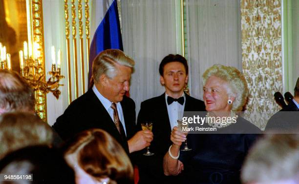 Russian President Boris Yeltsin and US First Lady Barbara Bush hold wine glasses during a toast at a State Dinner in the Russian Embassy, Washington...