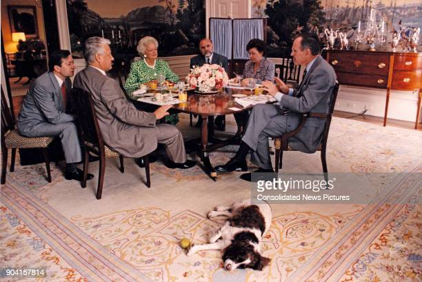 Russian President Boris Yeltsin and US President George HW Bush along with their wives First Lady Barbara Bush and Naina Yeltsina as they talk over...