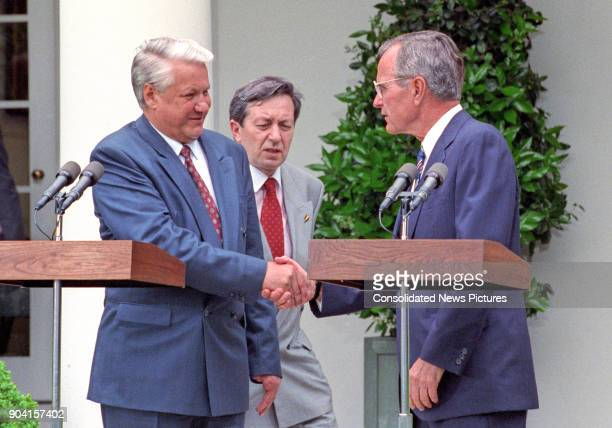 Russian President Boris Yeltsin and US President George HW Bush shake hands during a press conference in the White House's Rose Garden Washington DC...
