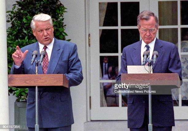 Russian President Boris Yeltsin and US President George HW Bush speak during a press conference in the White House's Rose Garden Washington DC June...