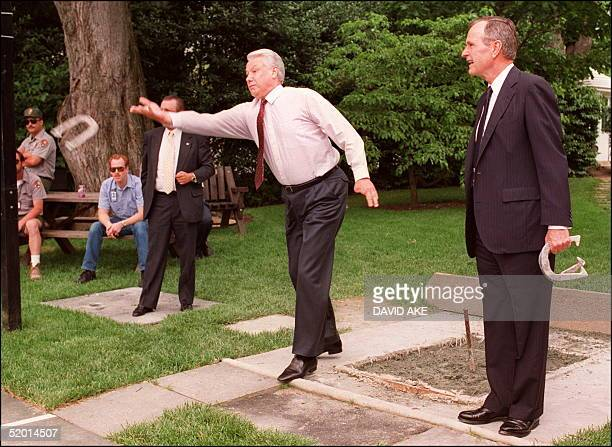 Russian President Boris Yeltsin shown in picture dated 16 June 1992 in Washington DC throws a horseshoe while playing the game outside the White...