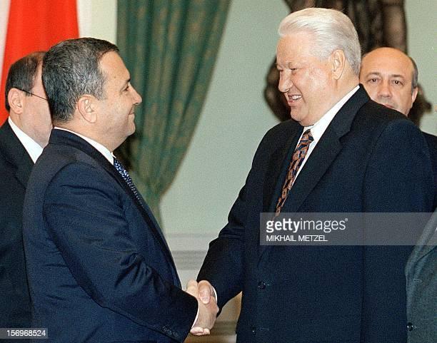 Russian President Boris Yeltsin smiles as he shakes hands with Israeli Prime Minister Ehud Barak, left, during their meeting in Moscow's Kremlin,...