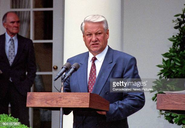 Russian President Boris Yeltsin speaks during a press conference in the White House's Rose Garden Washington DC June 16 1992 Along with US President...