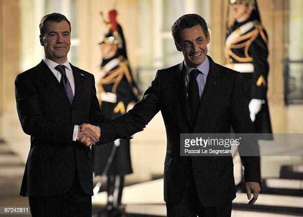 Russian President Dimitri Medvedev and French President Nicolas Sarkozy shake hands after their meeting at Elysee Palace on March 1 2010 in Paris...